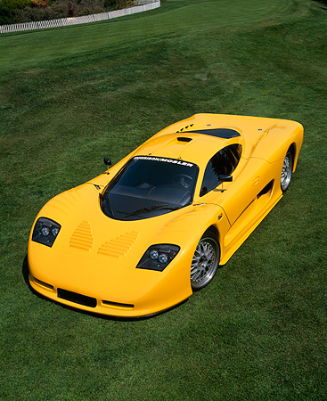 AUT 09 RK0512 02 © Kimball Stock 2002 Mosler MT900S Photon Yellow Overhead 3/4 Front View On Grass