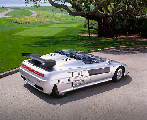 AUT 09 RK0593 01 © Kimball Stock 1988 Audi Aztec Italdesign Giugiaro Spider Silver 3/4 Rear View On Pavement By Grass And Trees