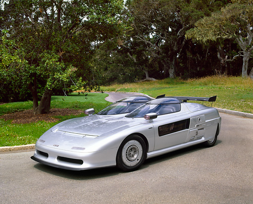 AUT 09 RK0598 03 © Kimball Stock 1988 Audi Aztec Italdesign Giugiaro Spider Silver 3/4 Front View On Pavement By Trees