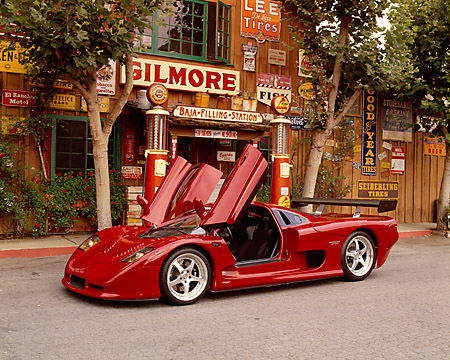 AUT 09 RK0655 02 © Kimball Stock 2003 Mosler MT900S Prototype Rosa Barchetta 3/4 Front View On Pavement By Building
