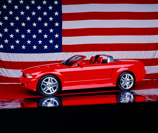AUT 09 RK0676 13 © Kimball Stock Ford Mustang GT Convertible Red 3/4 Side View On Mylar Floor America Flag Background