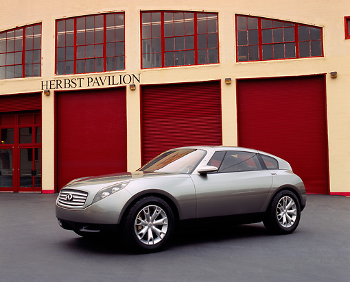 AUT 09 RK0696 03 © Kimball Stock Infiniti Triant Pewter Concept Car 3/4 Front View By Garage Doors