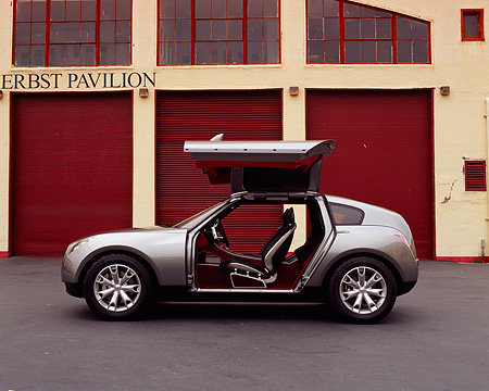 AUT 09 RK0699 03 © Kimball Stock Infiniti Triant Pewter Concept Car Profile Doors Open On Pavement By Garage Doors