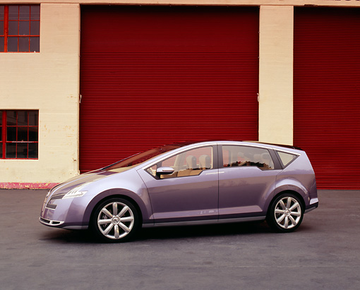 AUT 09 RK0706 03 © Kimball Stock Nissan Serenity Pewter Concept Car 3/4 Side View On Pavement By Garage Doors