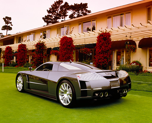 AUT 09 RK0752 01 © Kimball Stock Chrysler ME Four-Twelve Gray 3/4 Rear View On Grass By Building