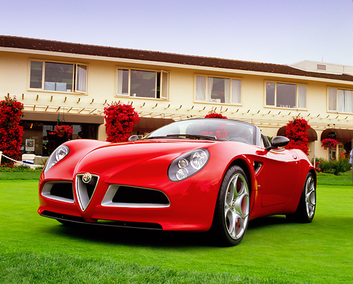 AUT 09 RK0791 05 © Kimball Stock Alfa Romeo 8C Spider Red Low 3/4 Front View On Turf By Building