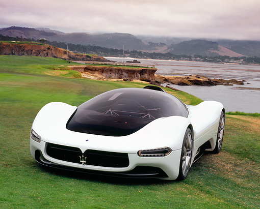 AUT 09 RK1005 01 © Kimball Stock Maserati Birdcage Pininfarina 75th Anniversary White 3/4 Front On Grass By Water