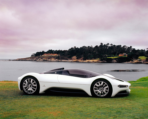 AUT 28 RK0213 01 © Kimball Stock Maserati Birdcage 75th Anniversary White Profile Shot On Grass By Water