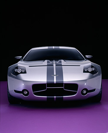 AUT 09 RK0818 10 © Kimball Stock 2004 Ford Shelby GR-1 Silver Head On View On Purple Floor Studio
