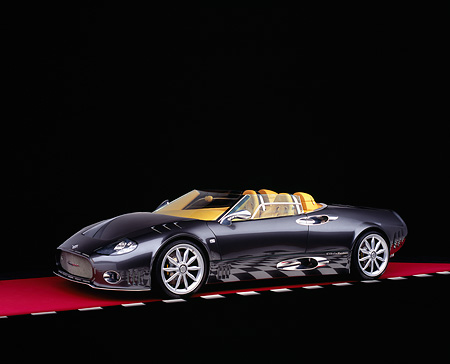 AUT 09 RK0830 07 © Kimball Stock 2005 Spyker C12 La Turbie Spyder Gray 3/4 Side View On Red Floor Checkered Line Studio