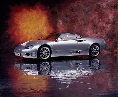AUT 09 RK0836 02 © Kimball Stock 2006 Spyker C8 Double 12 S Silver 3/4 Side View On Mylar Floor Studio