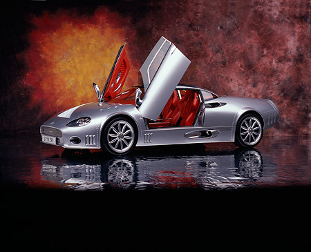 AUT 09 RK0837 06 © Kimball Stock 2006 Spyker C8 Double 12 S Silver 3/4 Side View Doors Open On Mylar Floor Studio