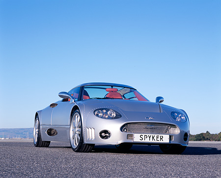 AUT 09 RK0842 02 © Kimball Stock 2006 Spyker C8 Double 12 S Silver Low 3/4 Front View  On Pavement Blue Sky