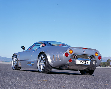 AUT 09 RK0849 01 © Kimball Stock 2006 Spyker C8 Double 12 S Silver Low 3/4 Rear View On Pavement Blue Sky