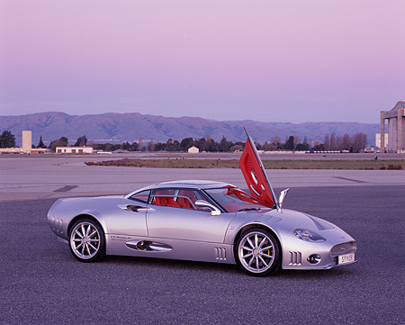 AUT 09 RK0854 01 © Kimball Stock 2006 Spyker C8 Double 12 S Silver 3/4 Side View Door Open On Pavement At Dusk