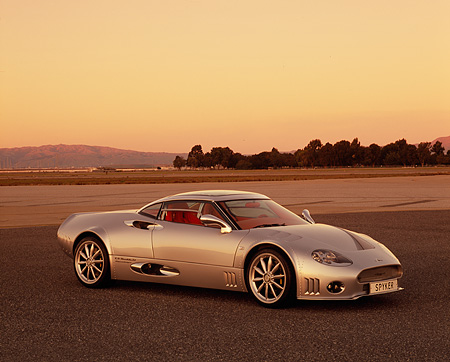 AUT 09 RK0855 01 © Kimball Stock 2006 Spyker C8 Double 12 S Silver 3/4 Side View On Pavement At Dusk