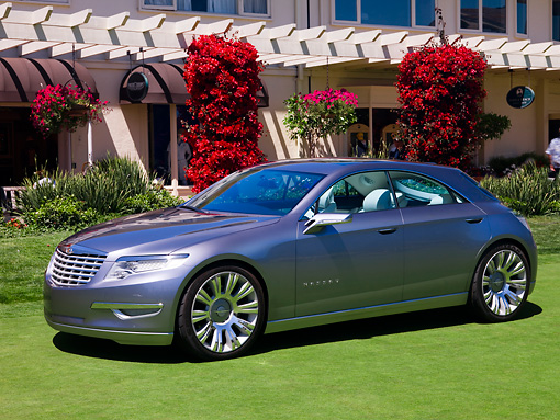 AUT 09 RK1020 01 © Kimball Stock Chrysler Nassau Concept Silver 3/4 Front View On Grass By Building Shrubs