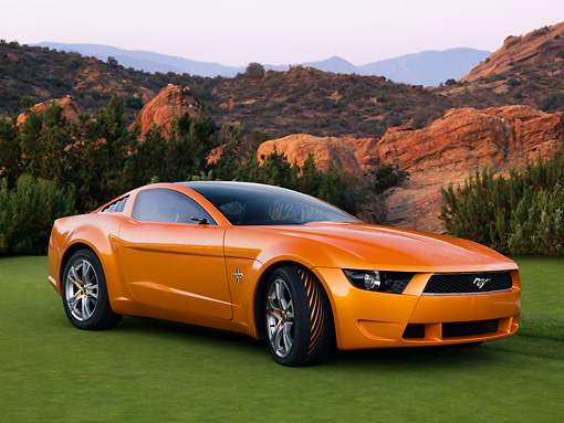 AUT 09 RK1031 01 © Kimball Stock Italdesign Mustang Concept By Giugiaro Orange 3/4 Front View On Grass By Mountains