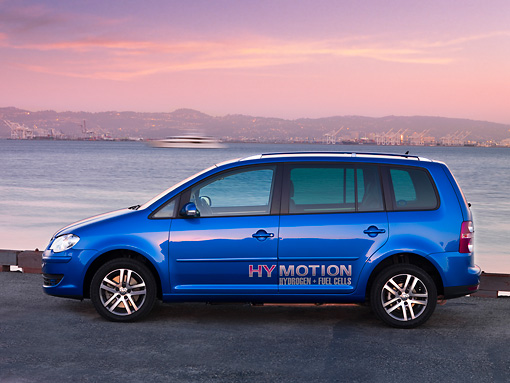 AUT 09 RK1039 01 © Kimball Stock Volkswagen Touran HyMotion Prototype Blue Profile View On Pavement By Water Hills Sky