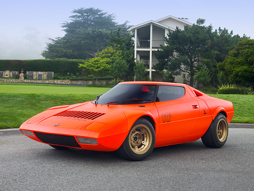 AUT 09 RK1065 01 © Kimball Stock 1970 Lancia Stratos HF Prototype Bertone Coupe DayGlo Red 3/4 Front View On Pavement By Lawn