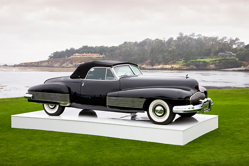 AUT 09 RK1072 01 © Kimball Stock 1938 Buick Y-Job Concept Convertible Black 3/4 Front View On Platform On Grass By Ocean