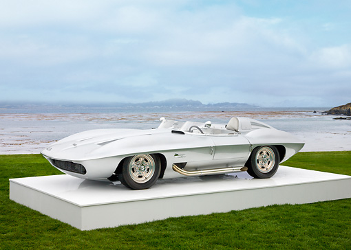 AUT 09 RK1074 01 © Kimball Stock 1959 Chevrolet Corvette Stingray Racer Special Silver White 3/4 Front View On Platform On Grass