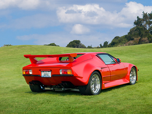 AUT 10 RK0033 01 © Kimball Stock 1971 De Tomaso Pantera Pre-L Red 3/4 Rear View On Grass