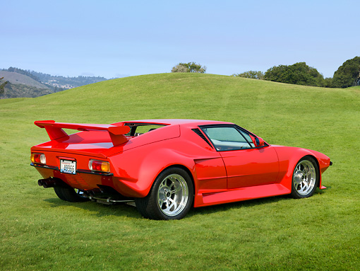 AUT 10 RK0034 01 © Kimball Stock 1971 De Tomaso Pantera Pre-L Red 3/4 Rear View On Grass