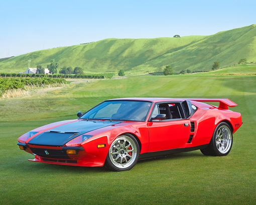 AUT 10 RK0037 01 © Kimball Stock 1974 De Tomaso Pantera Red 3/4 Front View On Grass By Hills