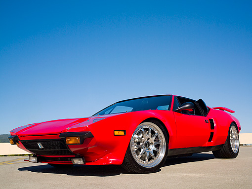 AUT 10 RK0021 01 © Kimball Stock 1974 De Tomaso Pantera Red  Low 3/4 Side View On Pavement