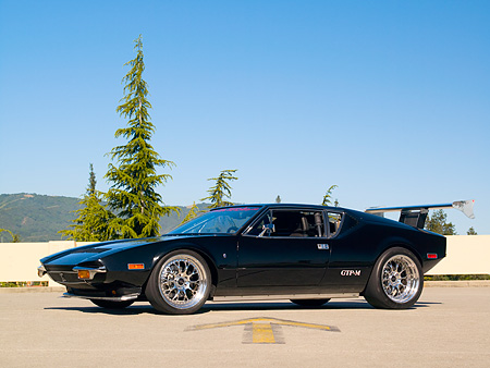 AUT 10 RK0025 01 © Kimball Stock 1974 De Tomaso Pantera Black Low 3/4 Side View On Pavement