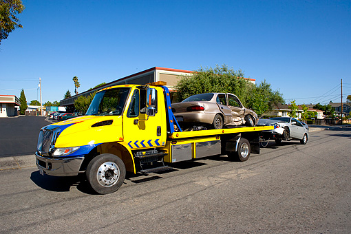 AUT 11 RK0005 01 © Kimball Stock Tow Truck Towing Two Crashed Cars