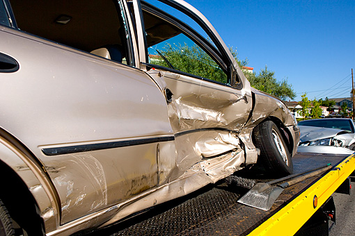 AUT 11 RK0006 01 © Kimball Stock Close Up Of Crashed Damaged Car On Tow Truck Bed