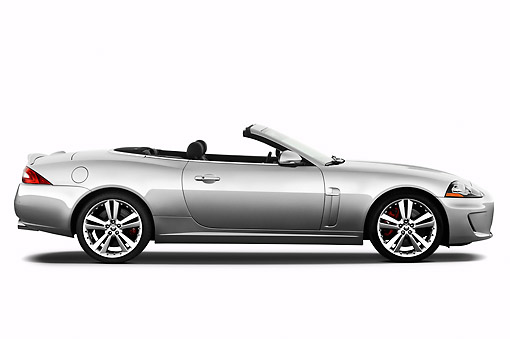 AUT 12 IZ0018 01 © Kimball Stock 2011 Jaguar XKR Convertible Silver Profile View On White Seamless
