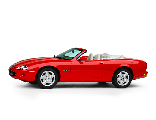 AUT 12 RK0063 03 © Kimball Stock 1999 Jaguar XK8 Convertible Red 3/4 Side View On White Seamless Studio