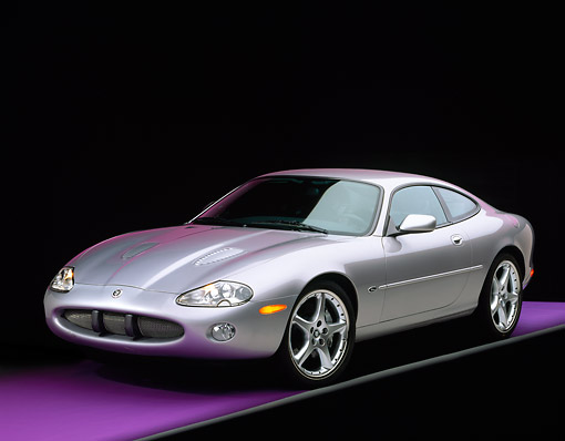 AUT 12 RK0108 03 © Kimball Stock 2001 Jaguar XKR Silverstone Coupe 3/4 Front View On Purple Floor Gray Line Studio