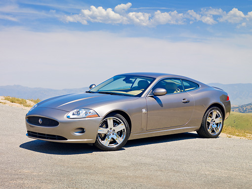 AUT 12 RK0320 01 © Kimball Stock 2009 Jaguar XK Coupe Gray 3/4 Front View On Pavement