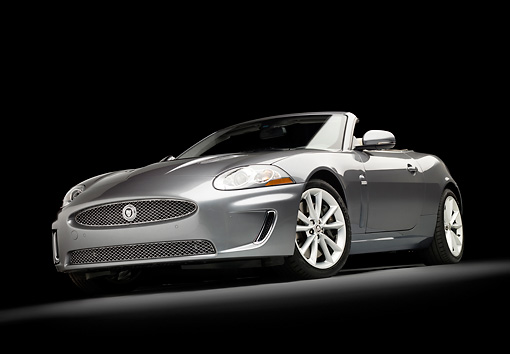AUT 12 RK0332 01 © Kimball Stock 2010 Jaguar XKR Convertible Silver 3/4 Front View Studio