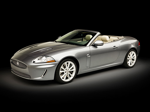 AUT 12 RK0333 01 © Kimball Stock 2010 Jaguar XKR Convertible Silver 3/4 Front View Studio