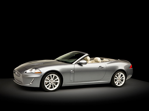AUT 12 RK0334 01 © Kimball Stock 2010 Jaguar XKR Convertible Silver 3/4 Front View Studio