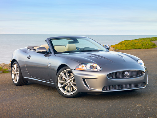 AUT 12 RK0337 01 © Kimball Stock 2010 Jaguar XKR Convertible Silver 3/4 Front View On Pavement By Water