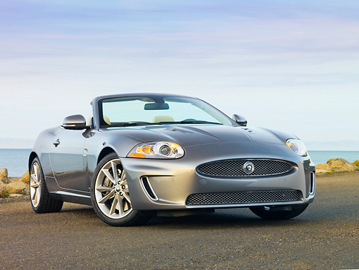 AUT 12 RK0340 01 © Kimball Stock 2010 Jaguar XKR Convertible Silver 3/4 Front View On Pavement By Water
