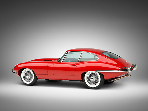 AUT 12 RK0350 01 © Kimball Stock 1966 Jaguar XKE Coupe Red 3/4 Side View Studio