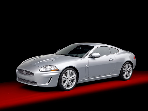 AUT 12 RK0351 01 © Kimball Stock 2011 Jaguar XKR Coupe Silver 3/4 Front View In Studio