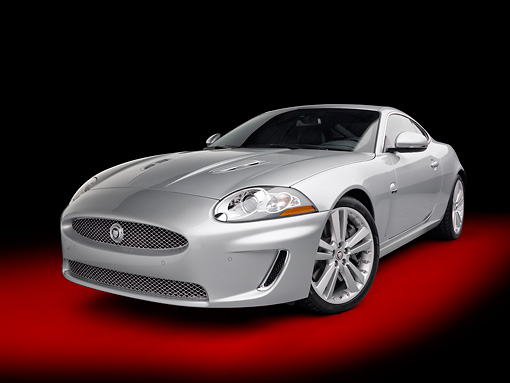 AUT 12 RK0353 01 © Kimball Stock 2011 Jaguar XKR Coupe Silver 3/4 Front View In Studio