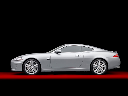 AUT 12 RK0356 01 © Kimball Stock 2011 Jaguar XKR Coupe Silver Profile View In Studio