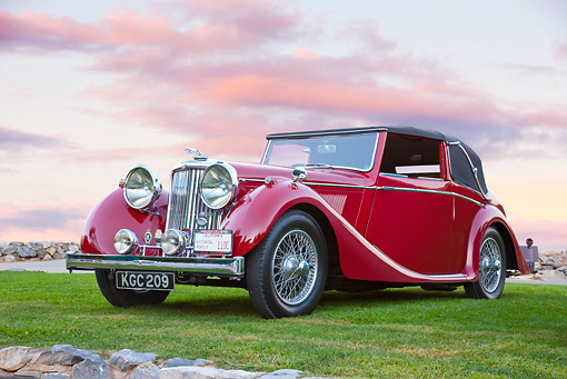 AUT 12 RK0367 01 © Kimball Stock 1948 Jaguar Mark IV Drophead Coupe Red 3/4 Front View On Grass At Dusk