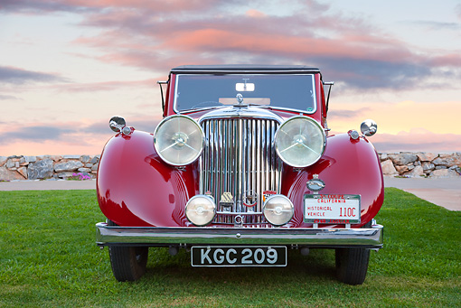 AUT 12 RK0368 01 © Kimball Stock 1948 Jaguar Mark IV Drophead Coupe Red Head On View On Grass At Dusk