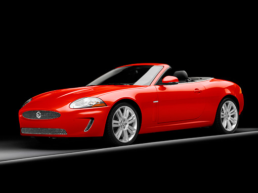 AUT 12 RK0371 01 © Kimball Stock 2010 Jaguar XKR Convertible Red 3/4 Front View Studio