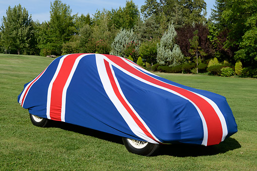 AUT 12 RK0373 01 © Kimball Stock Classic Jaguar With British Flag Car Cover 3/4 View On Grass By Trees